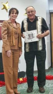 George Golombowski with San Juan College President, Dr. Toni Pendergrass