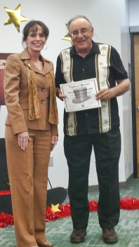 George Golombowski with San Juan College President, Dr. Toni Pendergrass